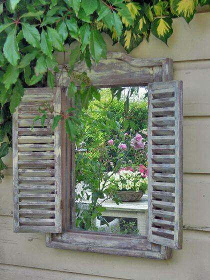 Frame a mirror in the garden for faux window!