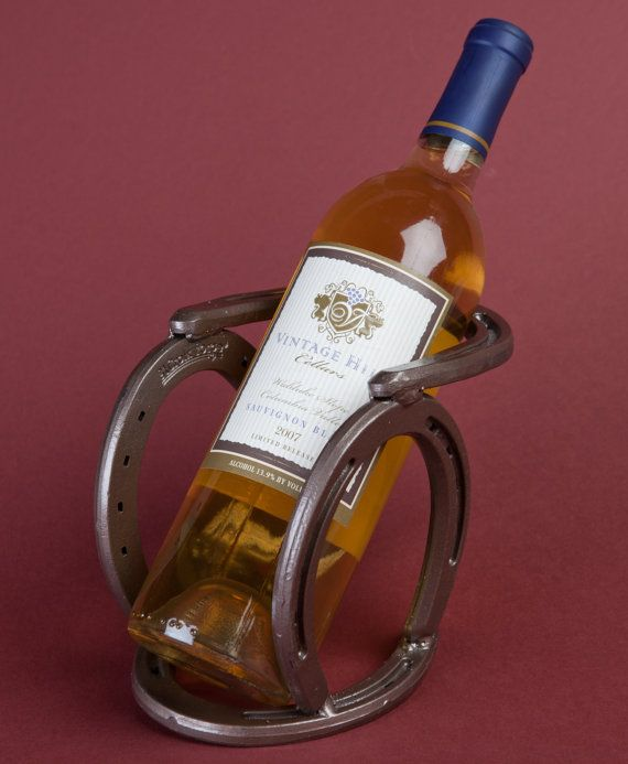 Western horseshoe wine bottle holder. Original design by Bar 18 Creations.