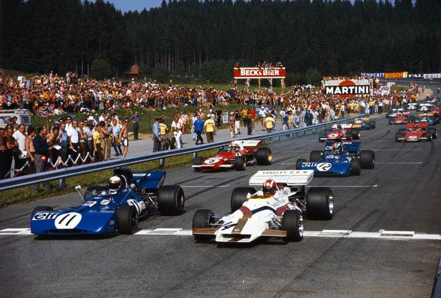 1971, Zeltweg, Austria — Jo Siffert in the BRM (No. 14), pole position, took the lead at the start of the 1971 Austrian Grand Prix. Beside him Jackie Stewart in the Tyrrell Ford-Cosworth. Behind them Francois Cevert in the 2nd Tyrrell and Clay Regazzoni in the Ferrari. — Image by © Schlegelmilch/Corbis
