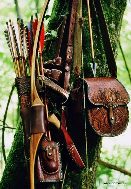 An elegant archer's accessories include gorgeous but practical leather pouches.