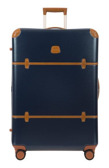 Free shipping and returns on Bric's Bellagio 2.0 32 Inch Rolling Spinner Suitcase at Nordstrom.com. Full-grain Tuscan leather trim adds understated elegance to a spacious yet lightweight suitcase crafted from durable polycarbonate for reliable protection. Four fully rotating wheels make for effortless navigation through crowds and to your destination.