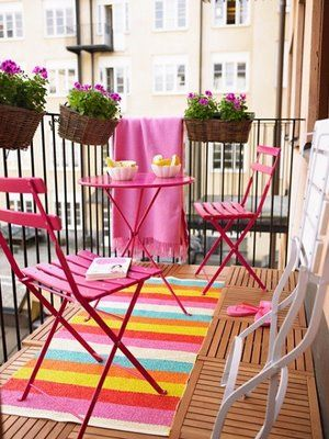 porch and balcony ideas - tiny, tiny balcony looks great with the addition of color