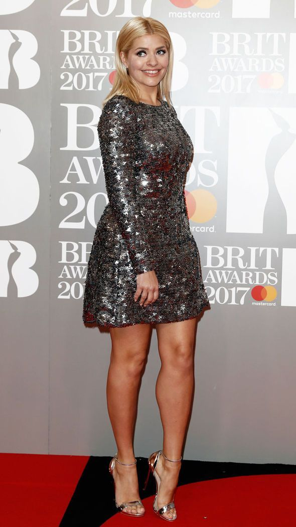 Holly Willoughby in silver sequin dress by fashion designer at Brit Awards 2017