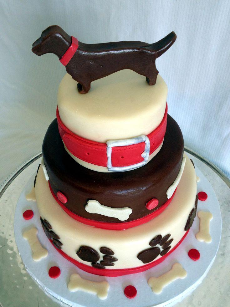 Three-tiered wiener dog themed birthday cake. Dachshund birthday cake.