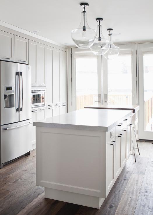 Three Kichler Everly Pendants Illuminate A White Kitchen