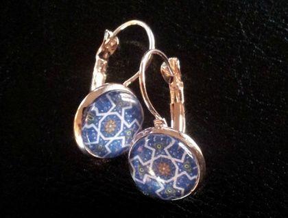 Rose gold coloured earrings