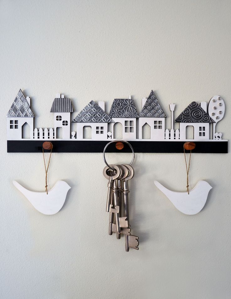 Village wooden cutout with pewter textured roofs, kit form from Mimmic Gallery…