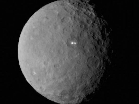 Mysterious Ceres Bright Spot Is Double! - NASA's Dawn spacecraft took this image on February 19, 2015, from a distance of 29,000 miles (46,000 km) of Ceres, the largest and most massive object in the asteroid belt. The image reveals that the brightest spot on Ceres has a dimmer companion which appears to share the same basin. Dawn will reach Ceres next Thursday on March 6, 2015
