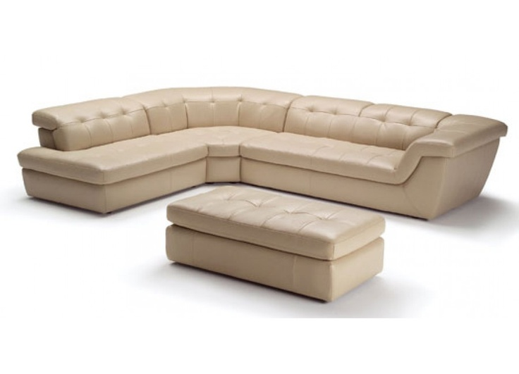 Sectional Sofa Upholstered In Tan Color Leather
