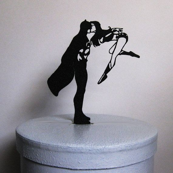 Batman and Wonder woman Wedding Cake topper made of 1/8 black ABS Plastic with non reflecting pebbled surface on the front and smooth back. ABS