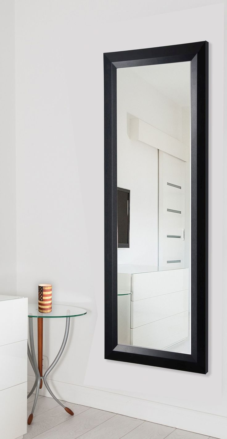 Features:  -Vertical and horizontal hanging hardware included.  -Ava collection.  -Material: Non-beveled glass.  -Frame material: Wood component.  -Frame color: Black.  -Full length tall size can also