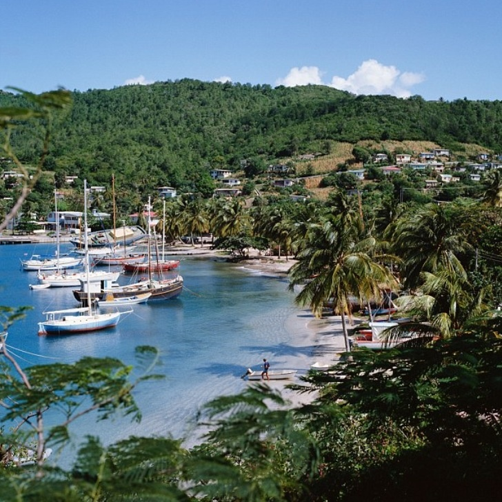 "Port Elizabeth, Bequia. Bequia is the largest island in the Grenadines at 7 square miles (18 km2). It is part of the country of Saint Vincent and the Grenadines and is approximately 15 kilometres (9.3 mi) from the nation's capital, Kingstown, on the main island, Saint Vincent. Bequia means ""island of the clouds"" in the ancient Arawak. The island's name was also 'Becouya' as part of the Granadilles."