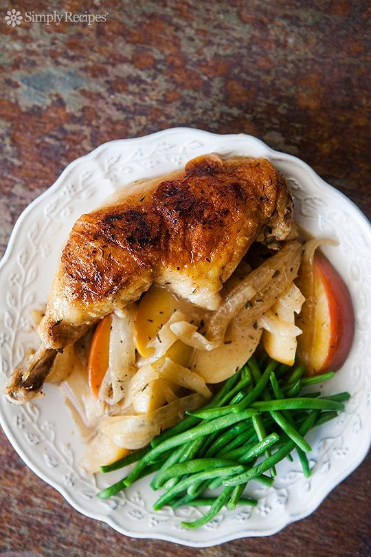Chicken, browned then braised in apple cider and brandy, cooked with apple slices and onions, served with a cream sauce. ~ SimplyRecipes.com