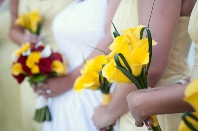 i really like the simplicity of this bouquet for the bridesmaids, having it be all yellow with maybe a tad of babies breath....i feel like a lot of bouquets look like a ball, but these look more like you just picked them - they fit together naturally