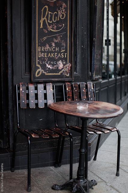 Love the color and stain on aged chairs and old table…  Café Saint Régis on Île Saint Louis by Paris in Four Months, via Flickr