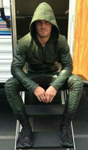 Stephen Amell dressed in the Arrow suit on set of Arrow