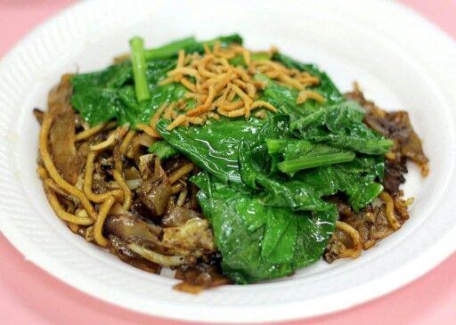 Char kway teow with chye sim and ikan billis as toppings.