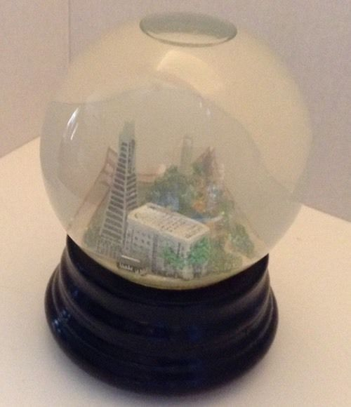Saks Fifth Avenue retired San Fransisco, CA wooden based musical snow globe. Sparkle inside, water is a little cloudy. Identifying mark for me was a taped on Saks Fifth Avenue label I will leave on.