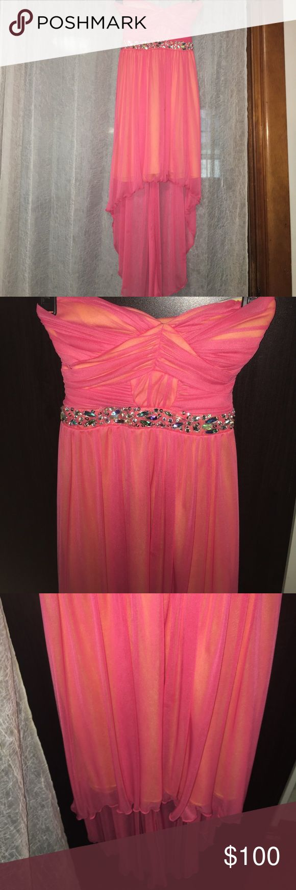 INEXPENSIVE HOMECOMING DRESS (NEED TP GET RID OF) Strapless bright hot coral pink dress bejeweled at midline. It is layered in the back as well! Willing to negotiate if needed! City Studio Dresses Prom