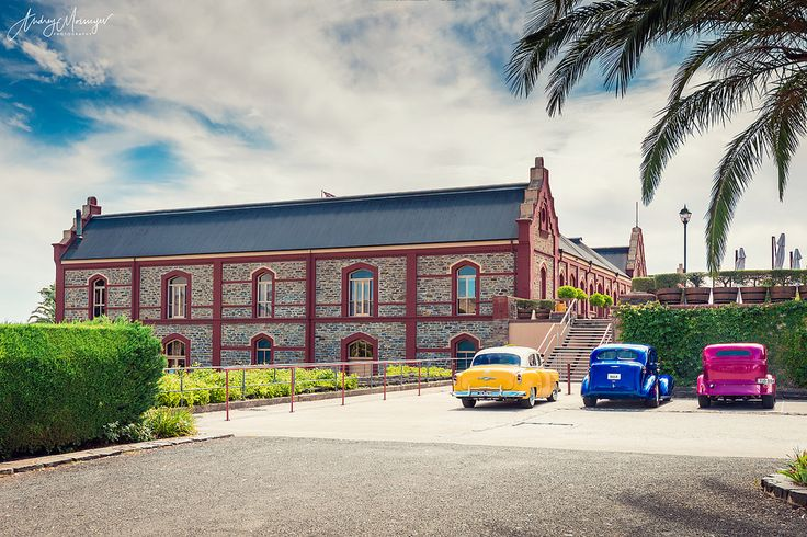 Vintage colourful cars parked near Chateau Tanunda winery
