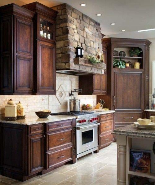 dark cabinets, stone range hood