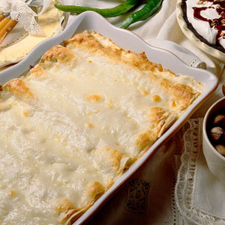 Creamy Chicken Enchiladas Recipe Main Dishes with butter, onions, green chile, cream cheese, cooked chicken breasts, flour tortillas, monterey jack, whipping cream