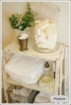 Eliminate any extra products you really don't need or use. Find unique containers like the glass jar above and fill with soap. Find wire baskets to hold extra towels.