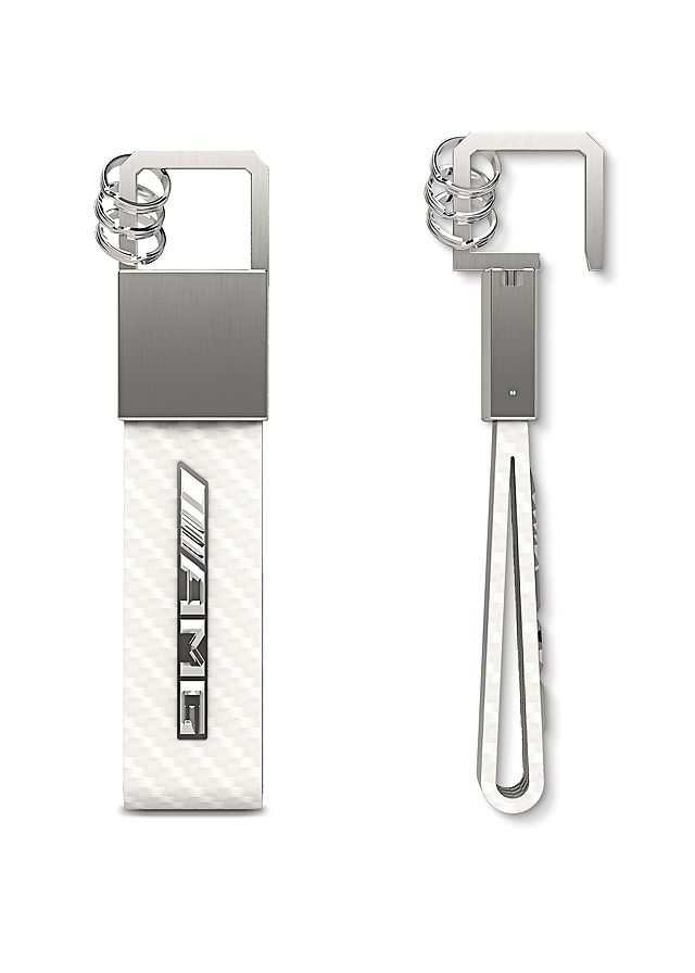 Part number:     B66953849  This sporty, elegant key ring, part of the AMG Collection, is made from white leather with a high-quality carbon leather look.  Matt brushed stainless steel and an elegant pull/twist mechanism provide an attractive contrast.