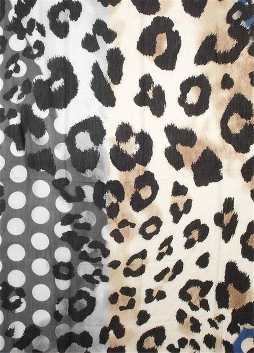 Juxtaposition of gridded dots and animal spots