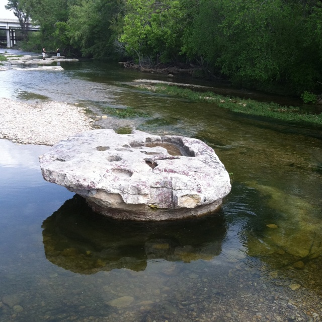 This is the round rock for which Round Rock Texas was named after. We would wade across Brushy Creek to stand on the rock. Sometimes, it was painted purple for the RR Dragons.