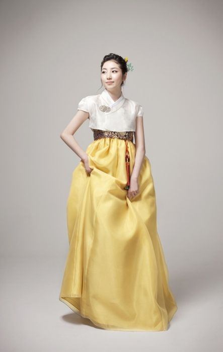 Stunning modern Hanbok - white cap sleeve jeogori, soft gold chima.  I'd like this color combo next time.