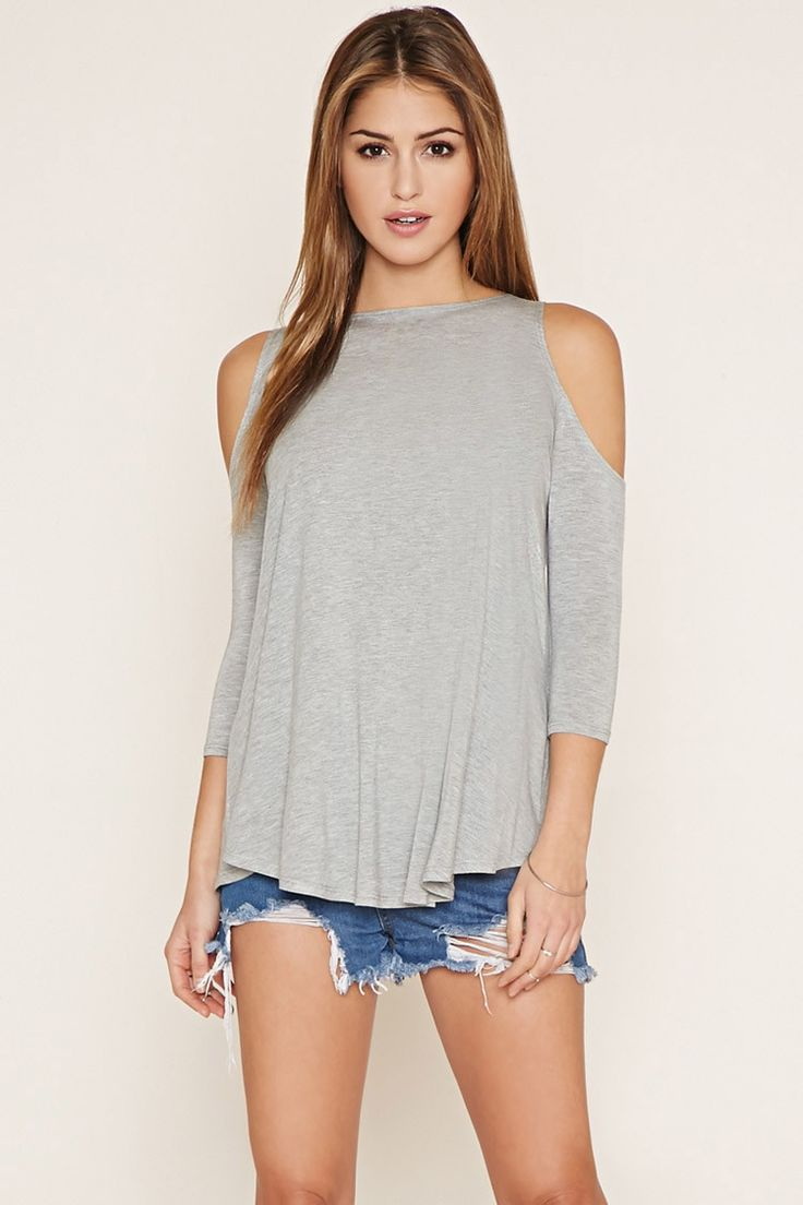 An open-shoulder knit top with a round neckline and 3/4 sleeves.