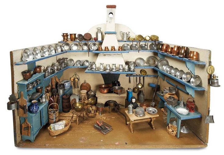 There are so many things to look at that you almost miss the small girl at the table. Theriault's Antique Doll Auctions