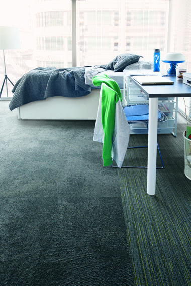 It is easy to rearrange a dorm room with this beautiful carpet. A dark grey carpet with a simple, textured pattern encompasses the center of the floor, while a subtle lime green linear pattern borders the outskirts of the bedroom. The floor design is a crucial finishing touch in spaces. Displaying Composure - Diffuse, Infuse - Clay_Lime.jpg