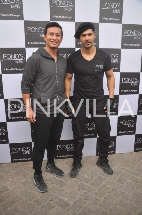 Varun sports 'Ninja' style look for an event, clicked with Baichung Bhutia! | PINKVILLA