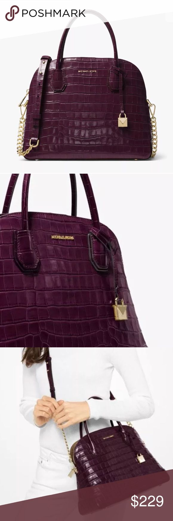 "Michael Kors Mercer Large Damson Leather Handbag 100% Authentic Michael Kors!  Buy with confidence!  Features: • 100% genuine Leather • Vlossy crocodile embossed leather, zip top fastening, gold-tone hardware, top handles • 4.5"" drop detachable • One zip and three open slip multifunction pockets, exterior two magnetic snap compartments, fabric lined interior, sleek new lock charm • 11.5"" bottom widest (L)/ 9.6"" center (H)/ 5""(W) bottom • Comes with dust bag  Please feel free to ask any…"