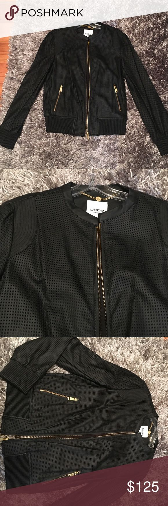 Bebe Black Leather Bomber Jacket Black leather bomber from Bebe, never worn. Leather looks perforated all around and has gold zippers bebe Jackets & Coats Utility Jackets