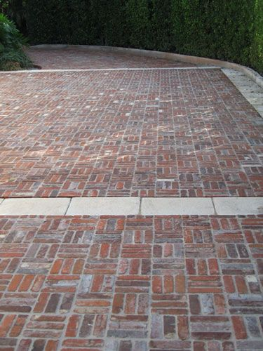 Old Madrid Pavers. These antique bricks were laid on edge in their original setting, a technique that's ideal for executing Old World designs of greater formality or complexity. They're available in a vibrant, light red to russet to burgundy color spectrum that, unlike color-stained concrete, will never fade.