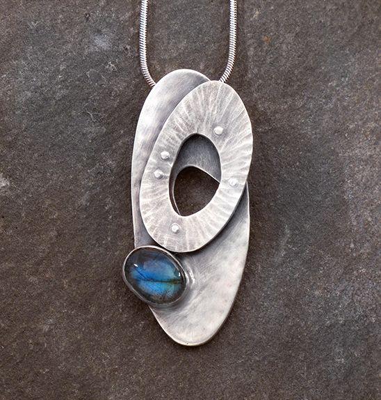 Silver and Spectrolite Petite Pendant - Sterling silver pendant with riveted floating layer and spectrolite cabochon.  Leslie Zemenek    LeslieZemenekJewelry