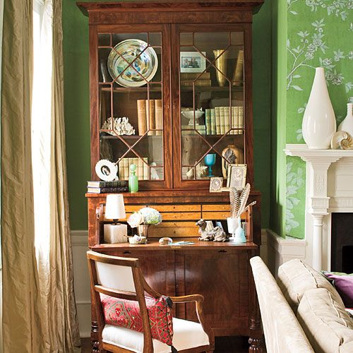 Antique secretary, hand painted green Chinoiserie wallpaper, soft golden taffeta drapes, crisp creamy upholstery.