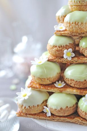 """French. """"Je veux une montagne de choux..."""" . Cake made of layered profiteroles. A craquelin is put on top of the pate a choux to create a crackled crust texture."""