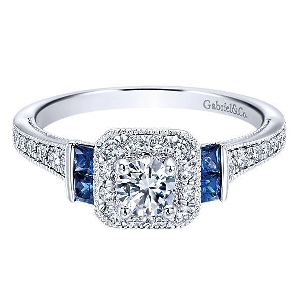 14K White Gold .56cttw Vintage Diamond and Sapphire Halo Engagement Ring. This ready to wear diamond engagement ring, features .56cttw of round diamonds with bead set side round diamonds. The center d