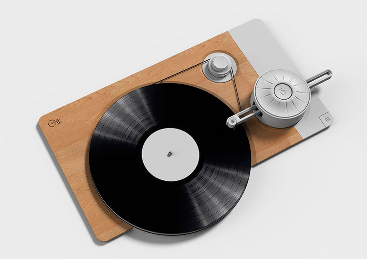 """This stripped-down turntable was designed to display the """"inner"""" workings of the device that would normally be shielded from the user's view. With an emphasis on linear movement, the simplistic yet enchanting turn of the needle, swivel record and power band create a beautiful connection between motion and music.  Designer: Yakir Buaron"""