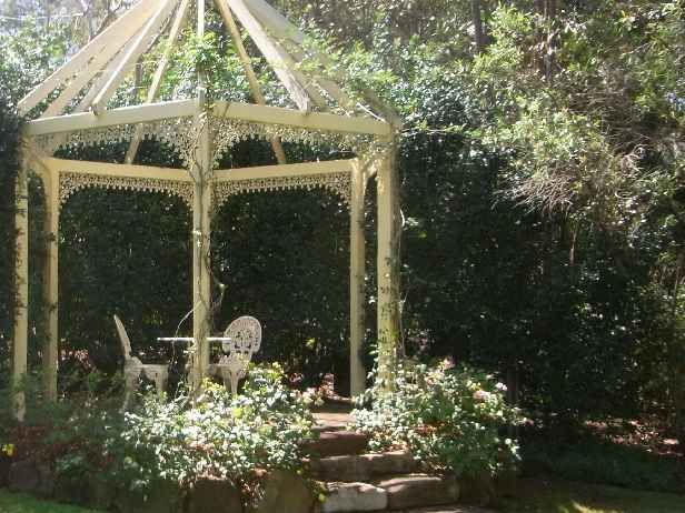 The graceful gazebo is perfect under the trees in the front garden