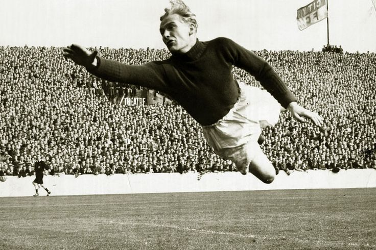 Bert Trautmann of Manchester City in full flight as he leaps across to cover a pile-driver from Rye in their First Division match against Wo...