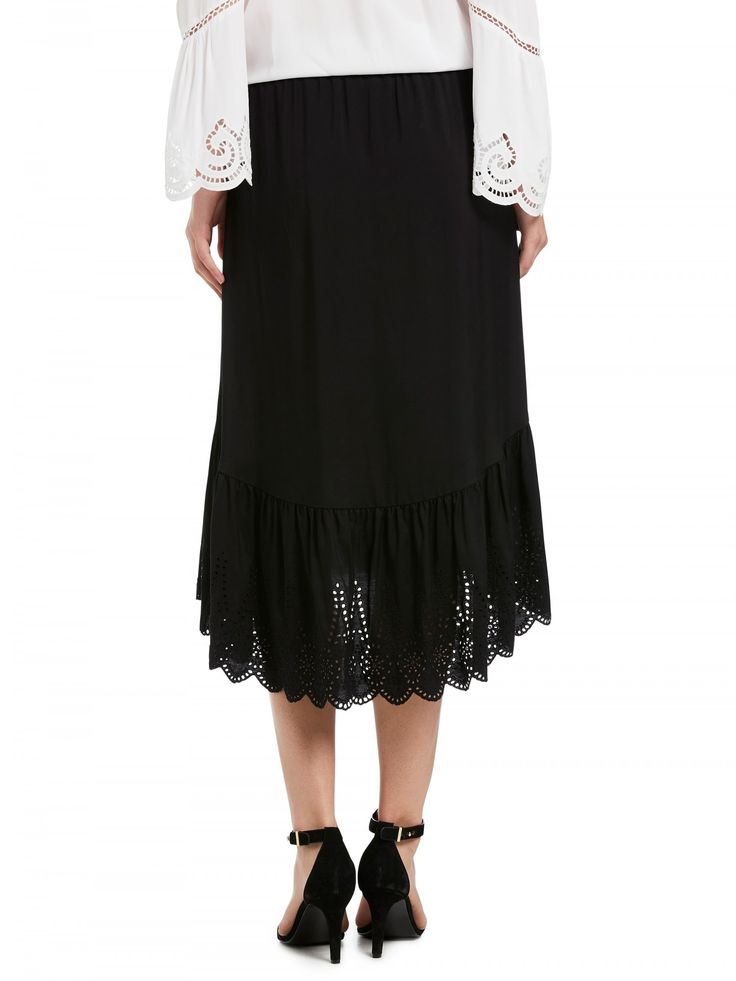 Featuring: - Elastic waist - Embroidery detail - Mini length - High low hem - Functional tassel tie