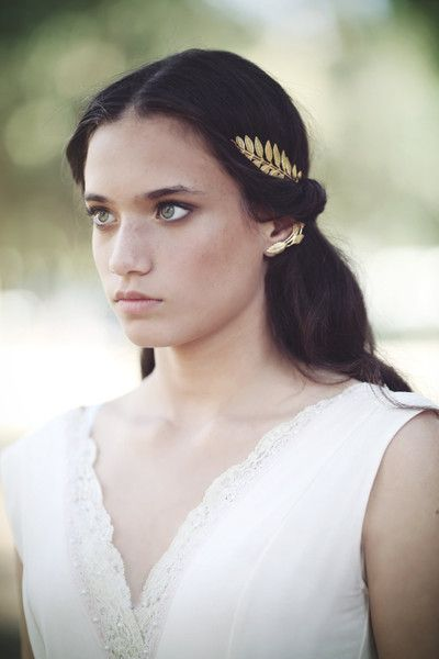 """This exquisite Greek goddess headband is almost the same as the loved and popular """"Athena"""" crown, only it has a cute twist to it- the big greek leaf is sealed with two small leaves and a pearl instead"""