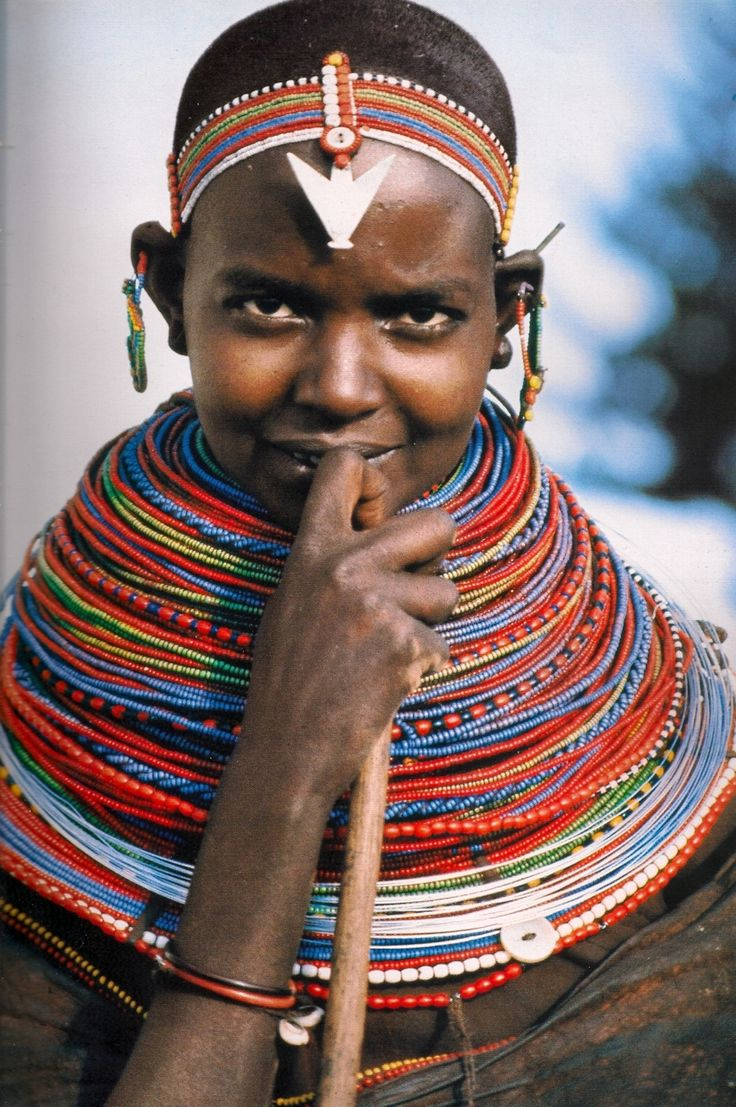 Kenya, Africa- Samburu girl wearing a nubility necklace stack. The girls in this East African culture receives the stands of loose beads from admirers, and once they have come up to the chin, she is ready for marriage.