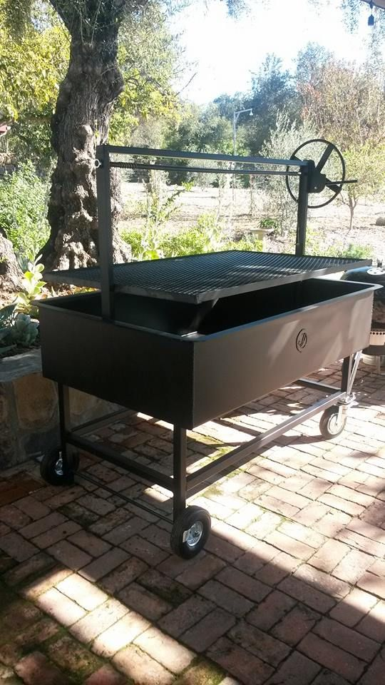 """Santa Maria Style BBQ pit grill. Designed and Fabricated by JD Fabrications. Our pits are completely welded together eliminating bolts.The crank guide stands 24"""" off the rim of the BBQ pit giving you over 34"""" of adjustable cooking height. This feature allows you to cook your meat at a desired heat stopping you from burning your meat. All our pits can be custom made please contact us with your ideas and we will make your dream BBQ pit."""