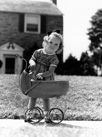 Playing 'Mommy' with a Doll Carriage....mom was ambitious for me and urged me to play Doctor with my dolls.  So I lined them up in the driveway and ran them over with the baby carriage.  Hey, they had to be injured before I could cure them, right?  I guess it only makes sense if you are five!